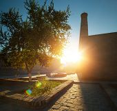 Oriental buildings in the city of Itchan Kala at sunrise. Khiva, Uzbekistan