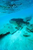 Underwater photo of a sunken drug plane at Exuma, Bahamas