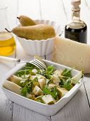 cheese and pears salad with balsamic vinegar and olive oil