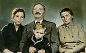 CEGLED, HUNGARY - CIRCA 1977: An antique photo shows hand painted portrait of a family - grandparent