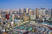 Tokyo, Japan cityscape aerial cityscape over Tsukiji Market at twilight.