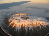 foto of kilimanjaro  - Fly over of Mount Kilimanjaro showing the effects of Global Warming on it - JPG