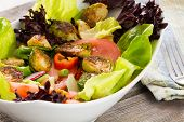 image of sauteed  - Bowl of healthy leafy mixed green salad with diced sauteed brussels sprouts tomato and radish served in a dish ready for a delicious nourishing snack - JPG