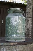 Large old metal milk can