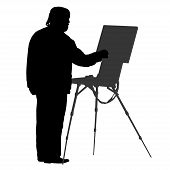 Silhouette of an artist at the easel.