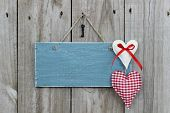 Antique blue sign with country red hearts and iron key