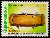 GUINEA - CIRCA 1989: A stamp printed in GUINEA shows Traditional Musical Instruments(bambalon), circ