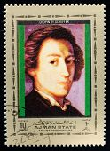AJMAN - CIRCA 1972: A stamp printed in Ajman shows portrait of the great musician and composer Frede