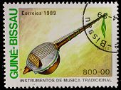 GUINEA - CIRCA 1989: A stamp printed in GUINEA shows Traditional Musical Instruments (kora), circa 1