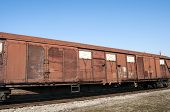 stock photo of wagon  - Obsolete wooden cargo railway wagon in perspective view - JPG