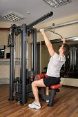 picture of lats  - Handsome young man doing B lats pull - JPG