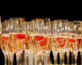 Rows of Champagne glasses with Raspberry Garnish