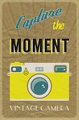 Retro photographic poster with the slogan Capture the Moment, on crumpled brown paper background. EP