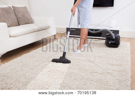 Maid Cleaning Carpet With Vacuum Cleaner poster