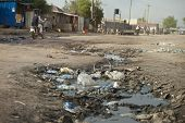 stock photo of sewage  - ditch full of sewage and garbage in street of South Sudan - JPG