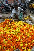KOKATA, INDIA - FEBRUARY 15: People buying and selling flowers and garlands at the flower market nex