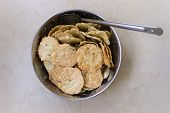 Indian savory crispy snack made from rice, black lentil, roasted gram flour
