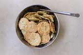 Indian savory crispy snack made from rice, black lentil, roasted gram flour