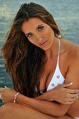 Outdoor portrait of beautiful model in white swimsuit