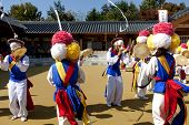 ANDONG-SI KOREA OCTORBER 26: People are performing folk dance at Hahoe Village on octorber 26 2013, Andong-si, Korea.