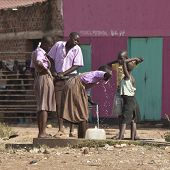 TORIT, SOUTH SUDAN-FEBRUARY 20 2013: Unidentified students drink from a well in the town of Torit, S