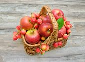 Apples In A Wicker Basket On A Wooden Background