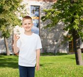 advertising, people and childhood concept - smiling little boy in white blank t-shirt making ok gest