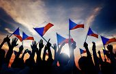 Silhouettes of People Holding Flag of Czech Republic