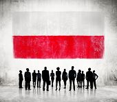 Silhouettes of Business People and a Flag of Poland