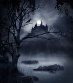stock photo of spooky  - view of a macabre castle on a hill in a dark night - JPG