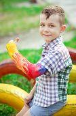 Portrait of boy with a broken arm in gypsum