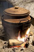 Clay Pot On Fire