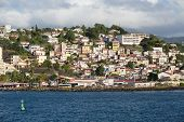 Colorful Homes On Martinique Coast With Green Channel Marker
