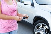 Unrecognizable Caucasian Woman With Ignition Key Standing Near Own Vehicle