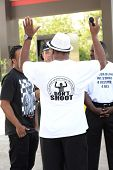 FERGUSON, MO/USA  AUGUST 15, 2014: Demonstrator interview at the site of destroyed Quick Trip react after Police Chief Thomas Jackson release of the name of the officer that shot Michael Brown.
