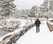 Senior female on snow covered trail