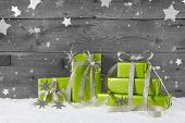 Green Christmas Background On Grey Wooden Background With Snow.