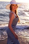 Beautiful Smiling Girl In Elegant Dress Posing On Beach