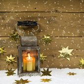 Christmas Mood: Old Rustic Latern On A Snowy Background.