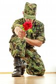 Military Soldier Kneeling Holding Red Rose