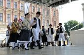 ZAGREB, CROATIA - JULY 19: Members of folk groups Zvon from Mala Subotica, Croatia during the 48th International Folklore Festival in center of Zagreb, Croatia on July 19, 2014
