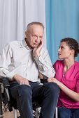 stock photo of geriatric  - Geriatric patient on wheelchair talking with nurse - JPG