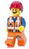 Ankara, Turkey - March 15, 2014 :  Lego movie minifigure character Emmet walking isolated on white b