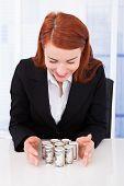 Businesswoman Protecting Rolled Dollar Bills