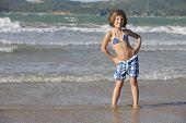 Happy little girl having fun on the beach.