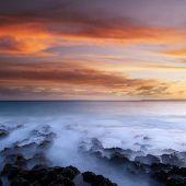 Sunset of beautiful coral reef coastline.