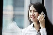Young Business Woman Speaking Mobile Phone.