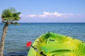 Seascape with a canoe
