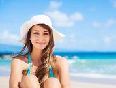 Portrait of beautiful young woman on the beach