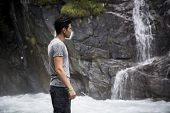 Handsome Young Man Near Mountain Waterfall